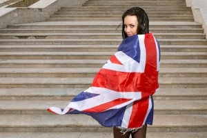 38872765 - young women with union jack flag against stairs.
